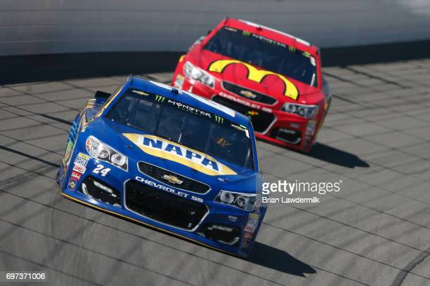 Chase Elliott driver of the NAPA Chevrolet leads Jamie McMurray driver of the McDonald's Chevrolet during the Monster Energy NASCAR Cup Series...