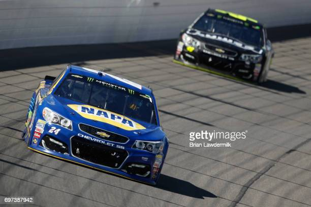 Chase Elliott driver of the NAPA Chevrolet leads Jimmie Johnson driver of the Lowe's Chevrolet during the Monster Energy NASCAR Cup Series...