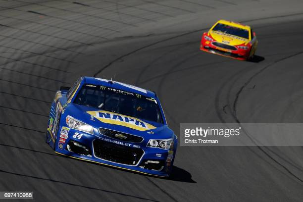 Chase Elliott driver of the NAPA Chevrolet leads Joey Logano driver of the Shell Pennzoil Ford during the Monster Energy NASCAR Cup Series...