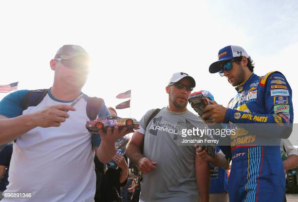 Chase Elliott driver of the NAPA Chevrolet signs autographs during practice for the Monster Energy NASCAR Cup Series FireKeepers Casino 400 at...