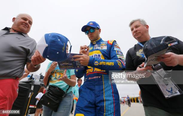 Chase Elliott driver of the NAPA Chevrolet signs autographs for fans during practice for the 59th Annual DAYTONA 500 at Daytona International...
