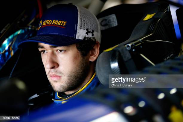 Chase Elliott driver of the NAPA Chevrolet sits in his car during practice for the Monster Energy NASCAR Cup Series FireKeepers Casino 400 at...