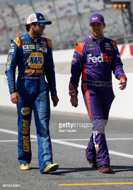 Chase Elliott driver of the NAPA Chevrolet speaks with Denny Hamlin driver of the FedEx Express Toyota on the grid during qualifying for the Monster...