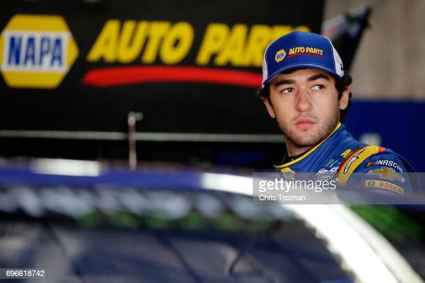 Chase Elliott driver of the NAPA Chevrolet stands in the garage area during practice for the Monster Energy NASCAR Cup Series FireKeepers Casino 400...