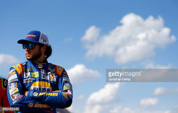 Chase Elliott driver of the NAPA Chevrolet stands on the grid during qualifying for the Monster Energy NASCAR Cup Series Pure Michigan 400 at...
