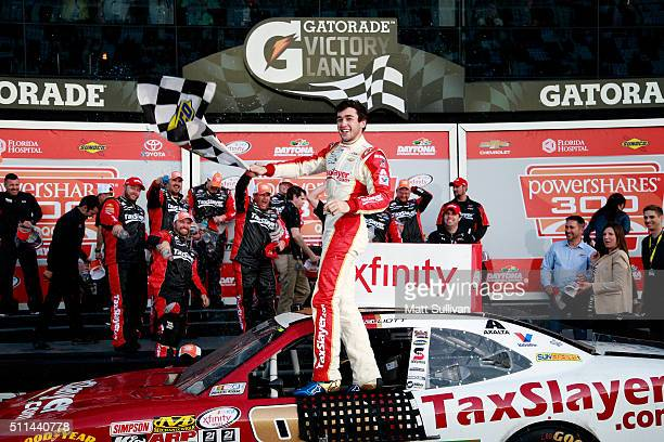 Chase Elliott driver of the TaxSlayercom Chevrolet celebrates in Victory Lane after winning the NASCAR XFINITY Series PowerShares QQQ 300 at Daytona...