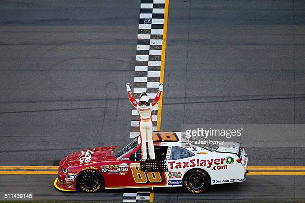 Chase Elliott driver of the TaxSlayercom Chevrolet celebrates winning the NASCAR XFINITY Series PowerShares QQQ 300 at Daytona International Speedway...
