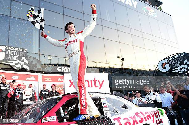 Chase Elliott driver of the TaxSlayercom Chevrolet celebrates winning the NASCAR XFINITY Series PowerShares QQQ 300 at Daytona International Speedway...