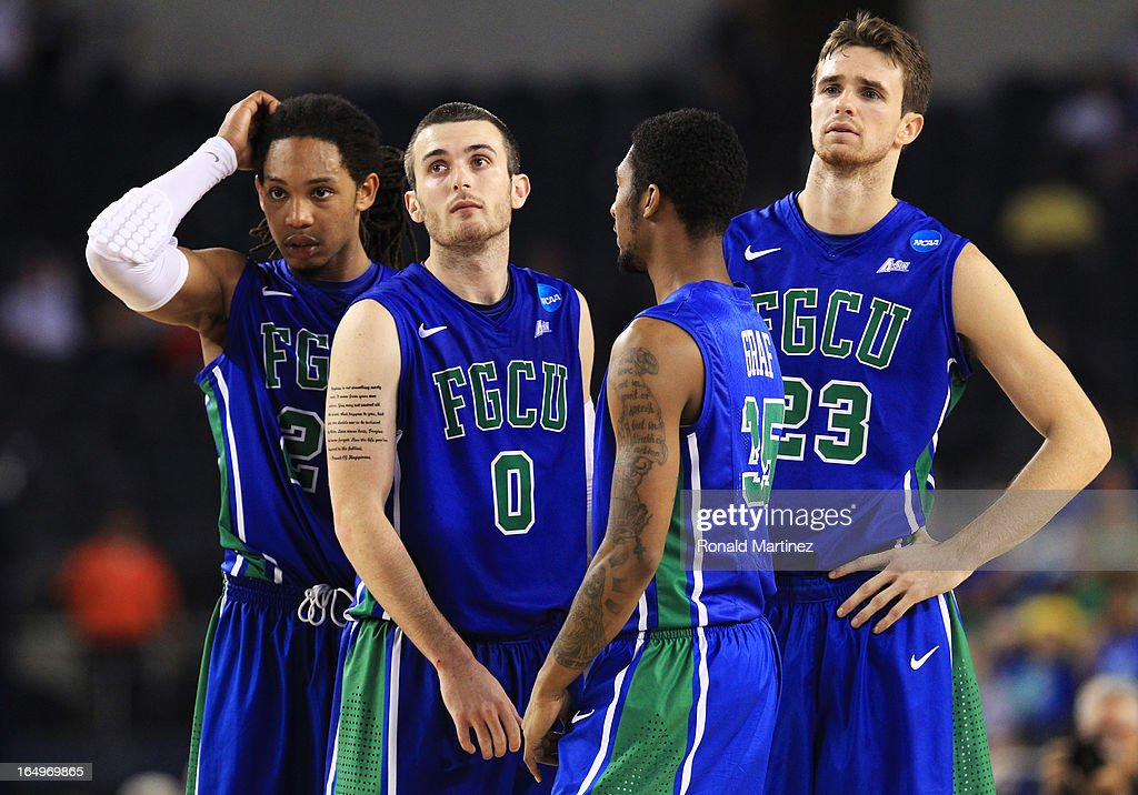 Chase Fieler #20, Dajuan Graf #35, Sherwood Brown #25, and Brett Comer #0 of the Florida Gulf Coast Eagles react late in the second half against the Florida Gators during the South Regional Semifinal round of the 2013 NCAA Men's Basketball Tournament at Dallas Cowboys Stadium on March 29, 2013 in Arlington, Texas.