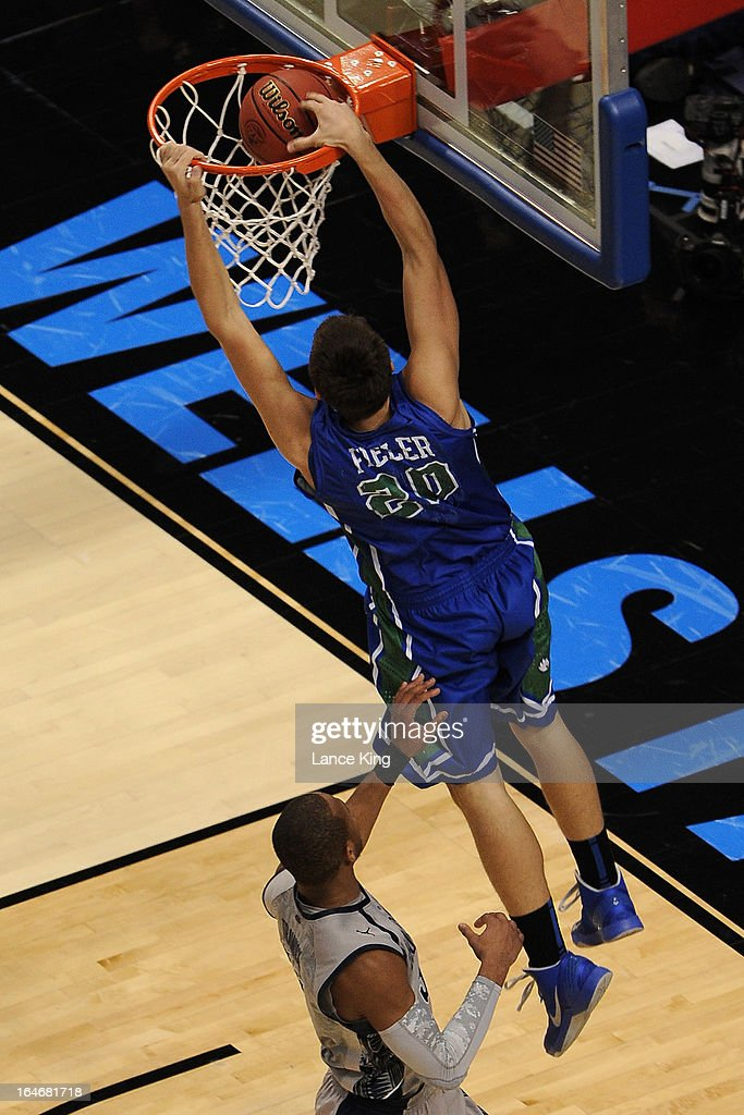 Chase Fieler #20 of the Florida Gulf Coast Eagles dunks against the Georgetown Hoyas during the second round of the 2013 NCAA Men's Basketball Tournament at the Wells Fargo Center on March 22, 2013 in Philadelphia, Pennsylvania. Florida Gulf Coast defeated Georgetown 78-68.