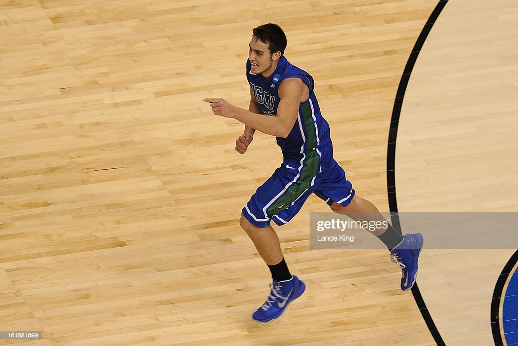 Chase Fieler #20 of the Florida Gulf Coast Eagles points to a teammate during a game against the Georgetown Hoyas during the second round of the 2013 NCAA Men's Basketball Tournament at the Wells Fargo Center on March 22, 2013 in Philadelphia, Pennsylvania. Florida Gulf Coast defeated Georgetown 78-68.