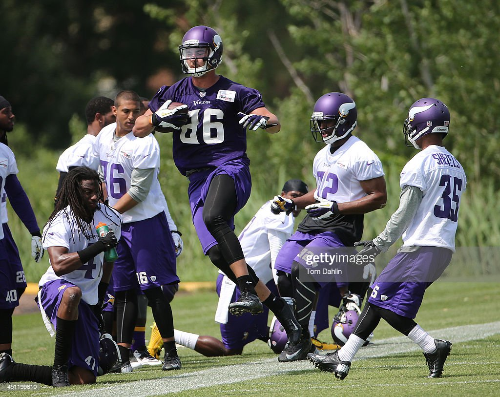 <a gi-track='captionPersonalityLinkClicked' href=/galleries/search?phrase=Chase+Ford&family=editorial&specificpeople=7167958 ng-click='$event.stopPropagation()'>Chase Ford</a> #86 of the Minnesota Vikings carries the ball at the Winter Park training facility on June 18, 2014 in Eden Prairie, Minnesota.
