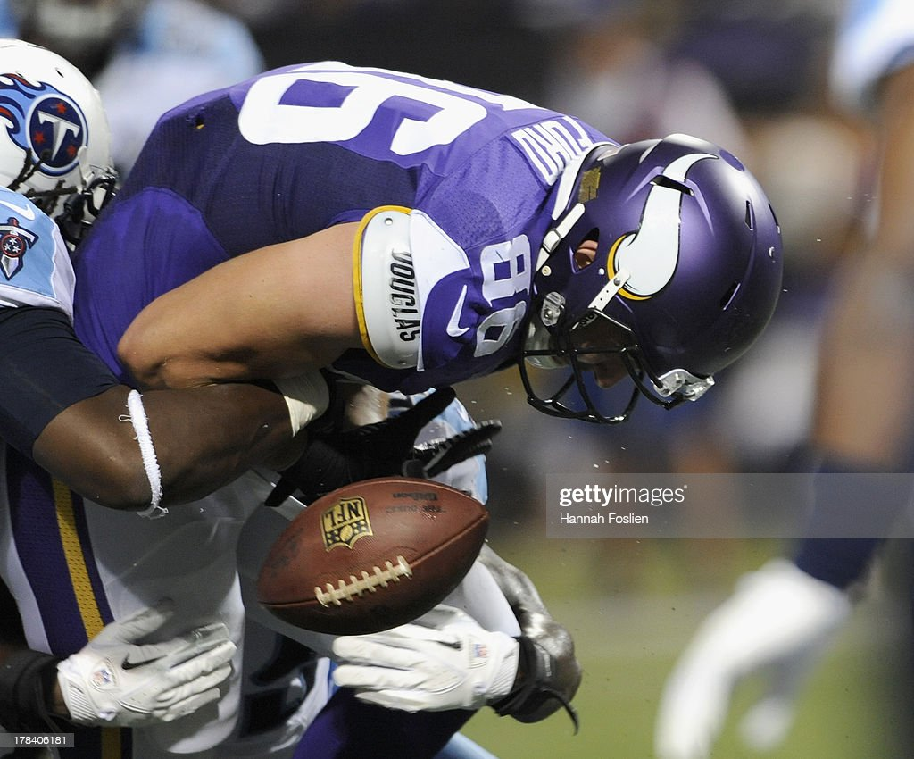 Chase Ford #86 of the Minnesota Vikings fumbles the ball during the third quarter of the game against the Tennessee Titans on August 29, 2013 at Mall of America Field at the Hubert H. Humphrey Metrodome in Minneapolis, Minnesota. The Vikings defeated the Titans 24-23.