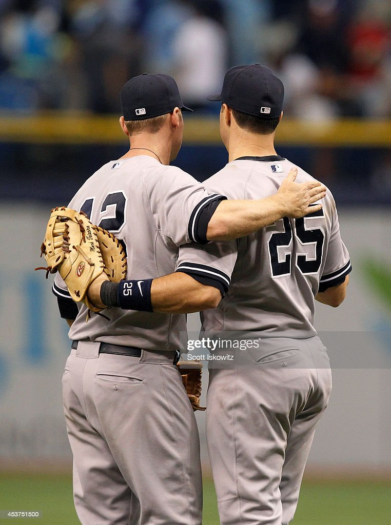 Chase Headley #12 of the New York Yankees and Mark Teixeira #25 of the New York Yankees celebrate after beating the Tampa Bay Rays 4-2 at Tropicana Field on August 17, 2014 in St Petersburg, Florida.