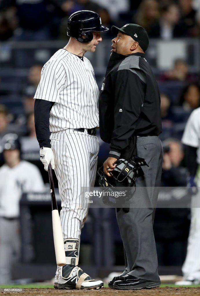 Chase Headley #12 of the New York Yankees argues home plate umpire Adrian Johnson #80 after Headley disagreed with a call in the seventh inning against the Houston Astros on May 12, 2017 at Yankee Stadium in the Bronx borough of New York City.