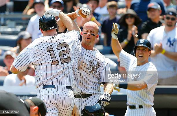 Chase Headley of the New York Yankees celebrates his first inning two run home run against the Kansas City Royals with teammates Brett Gardner and...