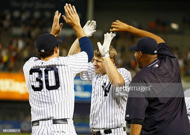 Chase Headley of the New York Yankees celebrates his ground out that scored the winning run in the tenth inning against the Minnesota Twins during...