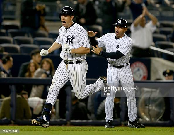 Chase Headley of the New York Yankees celebrates his solo home run as he runs by Joe Espada in the ninth inning against the Boston Red Sox on April...