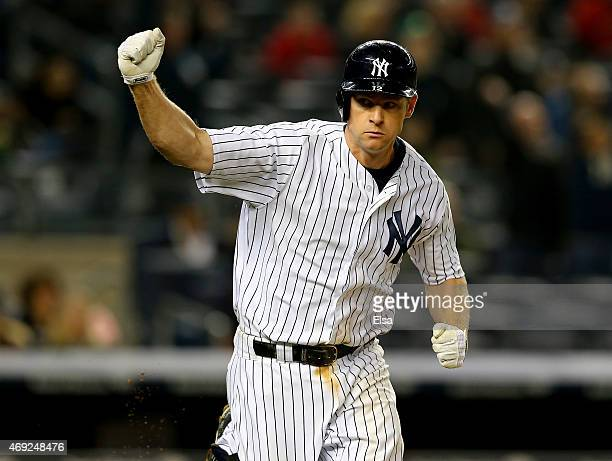 Chase Headley of the New York Yankees celebrates his solo home run in the ninth inning against the Boston Red Sox on April 10 2015 at Yankee Stadium...