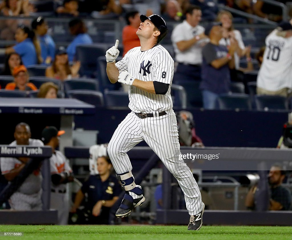 Chase Headley #12 of the New York Yankees celebrates his two run home run in the eighth inning against the Baltimore Orioles on July 19, 2016 at Yankee Stadium in the Bronx borough of New York City.