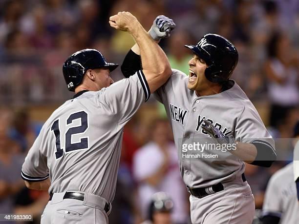 Chase Headley of the New York Yankees congratulates teammate John Ryan Murphy on a threerun home run against the Minnesota Twins during the ninth...