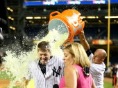 Chase Headley of the New York Yankees gets a gatorade bath by teammate Brett Gardner after the game against the Texas Rangers on July 23 2014 at...