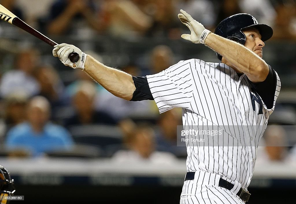 Chase Headley #12 of the New York Yankees hits a home run during the fifth inning against of the Detroit Tigers in a MLB baseball game at Yankee Stadium on August 6, 2014 in the Bronx borough of New York City.