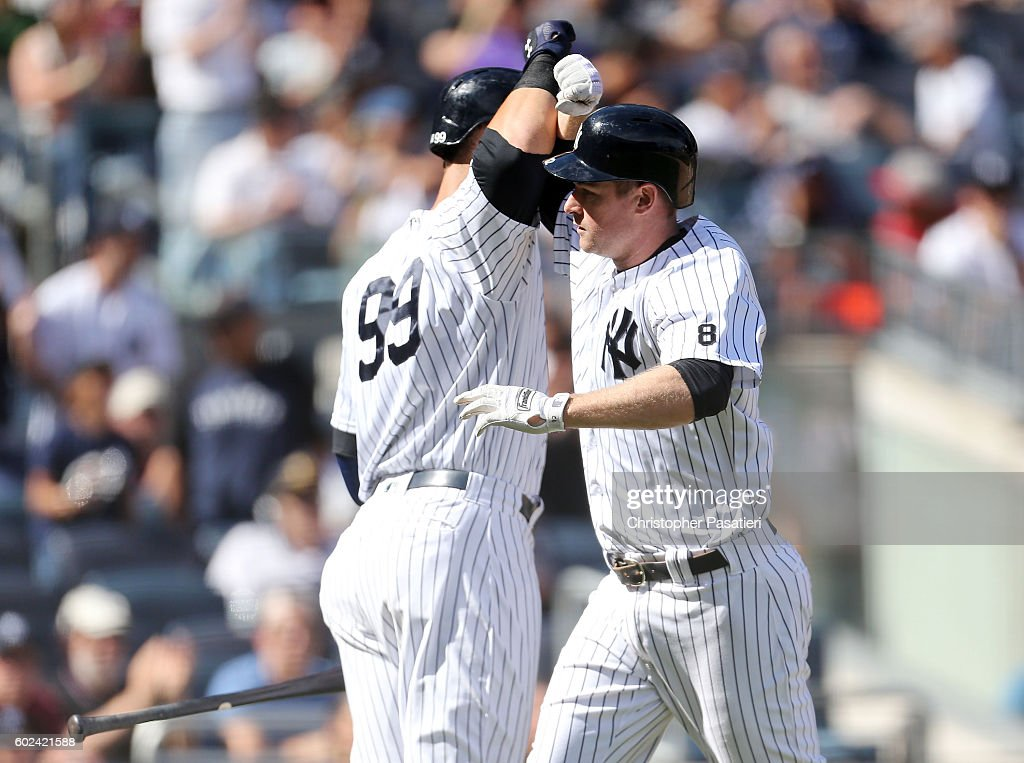 Chase Headley #12 of the New York Yankees is congratulated by Aaron Judge #99 after hitting a solo homerun in the bottom of the fifth inning against the Tampa Bay Rays on September 11, 2016 at Yankee Stadium in the Bronx borough of New York City.