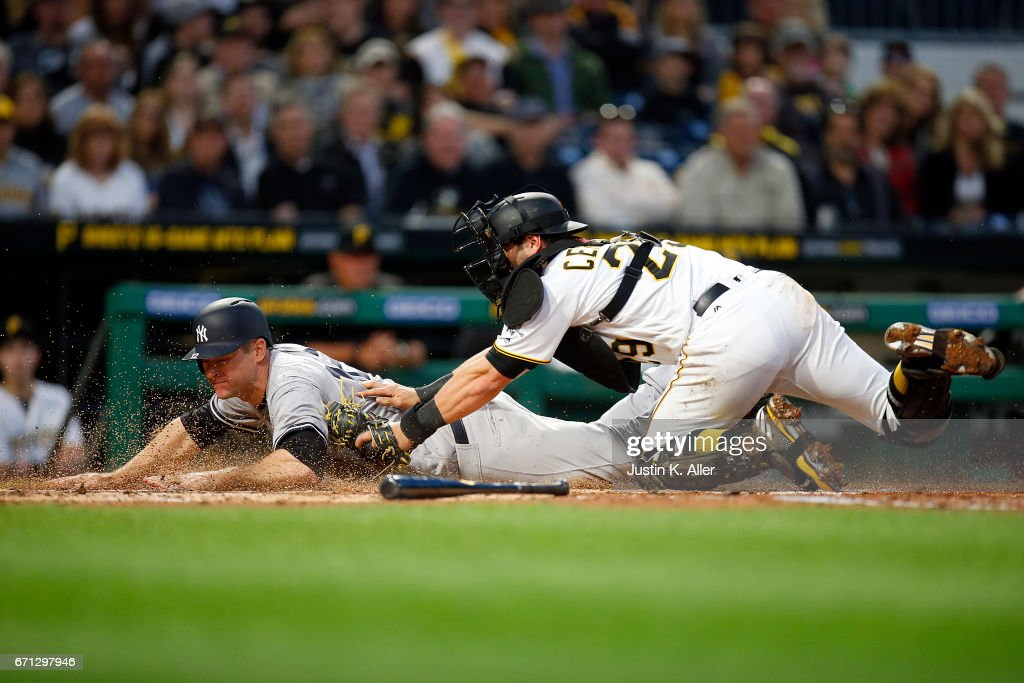 Chase Headley #12 of the New York Yankees is tagged out by Francisco Cervelli #29 of the Pittsburgh Pirates in the second inning at PNC Park on April 21, 2017 in Pittsburgh, Pennsylvania.