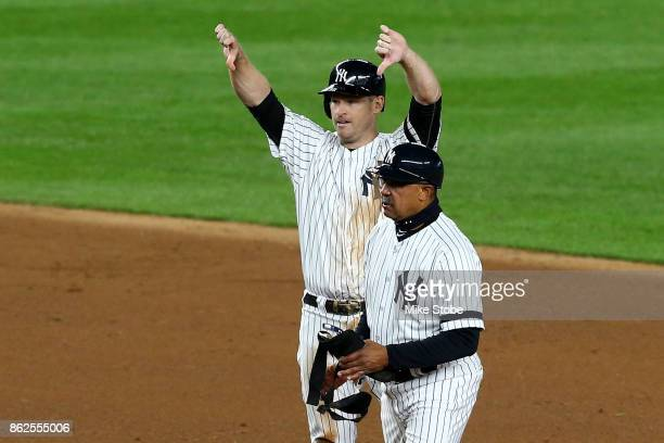 Chase Headley of the New York Yankees reacts after hitting a double during the eighth inning against the Houston Astros in Game Four of the American...