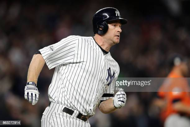 Chase Headley of the New York Yankees runs to first after a hit in the eighth inning against the Houston Astros looks on during Game Four of the...