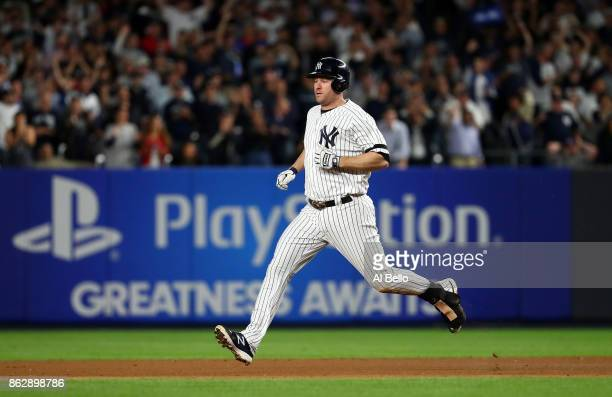 Chase Headley of the New York Yankees runs to second base after a single and overthrow at first base against the Houston Astros during the fifth...