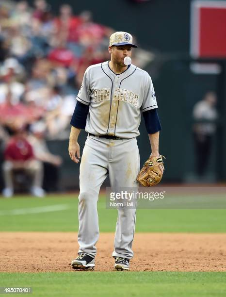 Chase Headley of the San Diego Padres blows a bubble while getting ready to make a play against the Arizona Diamondbacks at Chase Field on May 26...