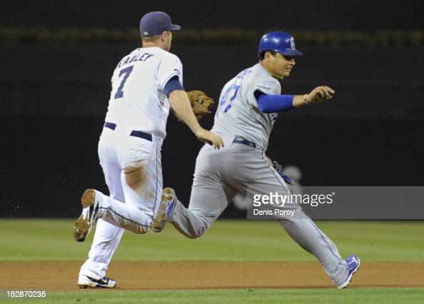 Chase Headley of the San Diego Padres catches Luis Cruz of the Los Angeles Dodgers in a rundown during the first inning of a baseball game at Petco...