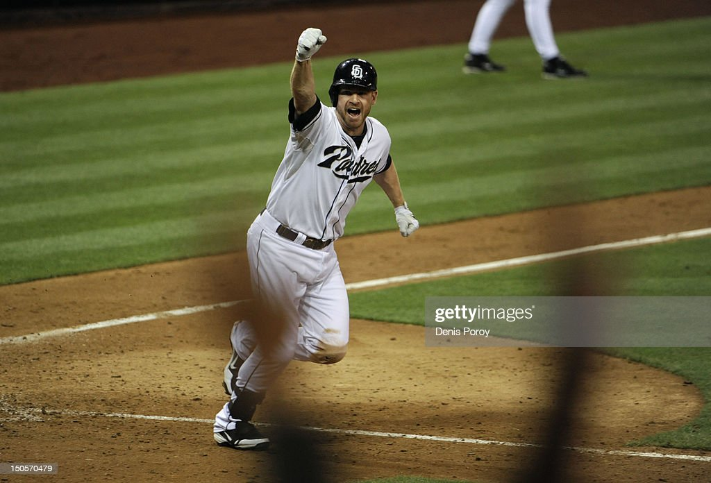 <a gi-track='captionPersonalityLinkClicked' href=/galleries/search?phrase=Chase+Headley&family=editorial&specificpeople=4353228 ng-click='$event.stopPropagation()'>Chase Headley</a> #7 of the San Diego Padres celebrates after hitting a walk-off home run in the 10th inning of a baseball game against the Pittsburgh Pirates at Petco Park on August 21, 2012 in San Diego, California. The Padres won 7-5.