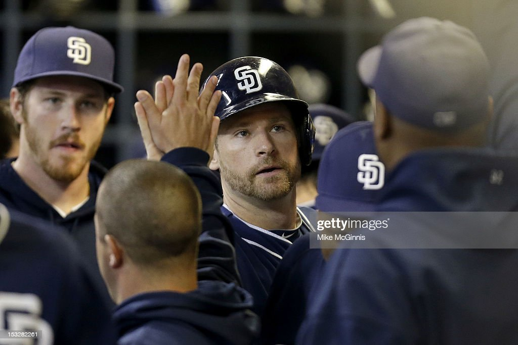 <a gi-track='captionPersonalityLinkClicked' href=/galleries/search?phrase=Chase+Headley&family=editorial&specificpeople=4353228 ng-click='$event.stopPropagation()'>Chase Headley</a> #7 of the San Diego Padres celebrates in the dugout after scoring on a single by Jesus Guzman in the top of the sixth inning against the Milwaukee Brewers at Miller Park on October 2, 2012 in Milwaukee, Wisconsin.