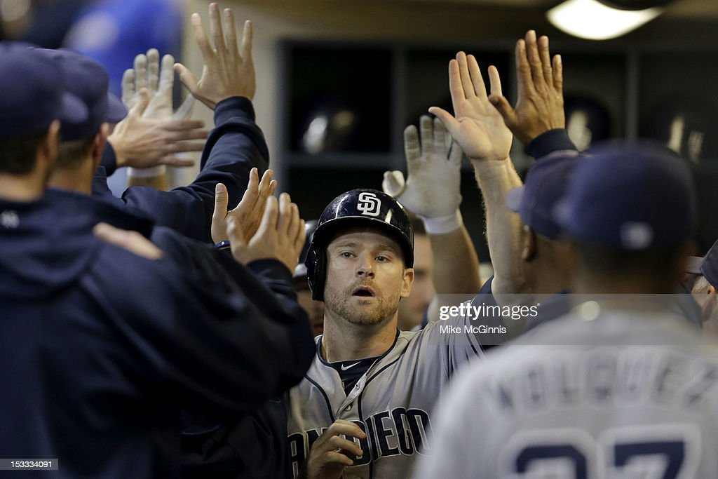 <a gi-track='captionPersonalityLinkClicked' href=/galleries/search?phrase=Chase+Headley&family=editorial&specificpeople=4353228 ng-click='$event.stopPropagation()'>Chase Headley</a> #7 of the San Diego Padres celebrates in the dugout after getting scoring in the top of the seventh inning putting the Padres up 7-6 over the Milwaukee Brewers at Miller Park on October 3, 2012 in Milwaukee, Wisconsin.