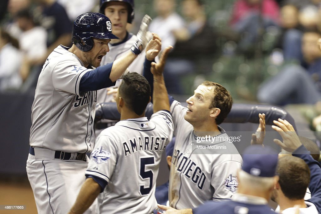 <a gi-track='captionPersonalityLinkClicked' href=/galleries/search?phrase=Chase+Headley&family=editorial&specificpeople=4353228 ng-click='$event.stopPropagation()'>Chase Headley</a> #7 of the San Diego Padres celebrates outside of the dugout after hitting a solo home run in the top of the 12th inning against the Milwaukee Brewers at Miller Park on April 22, 2014 in Milwaukee, Wisconsin.