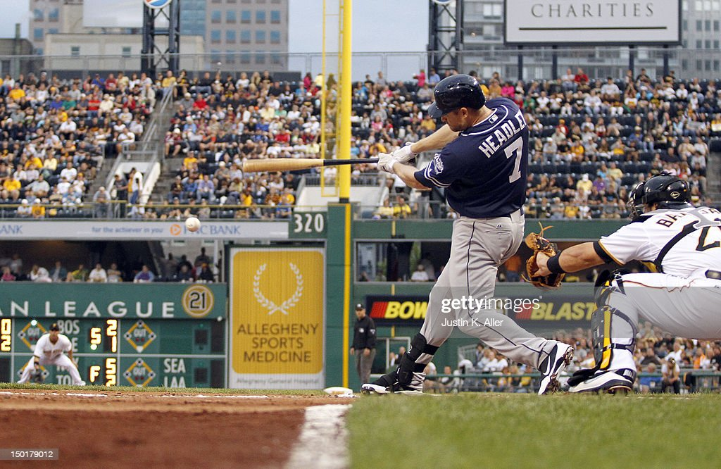 <a gi-track='captionPersonalityLinkClicked' href=/galleries/search?phrase=Chase+Headley&family=editorial&specificpeople=4353228 ng-click='$event.stopPropagation()'>Chase Headley</a> #7 of the San Diego Padres gets an RBI ground out in the third inning against the Pittsburgh Pirates during the game on August 11, 2012 at PNC Park in Pittsburgh, Pennsylvania.