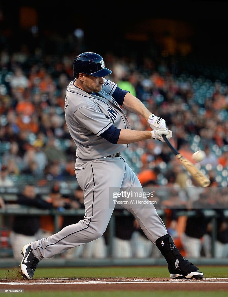 <a gi-track='captionPersonalityLinkClicked' href=/galleries/search?phrase=Chase+Headley&family=editorial&specificpeople=4353228 ng-click='$event.stopPropagation()'>Chase Headley</a> #7 of the San Diego Padres hits a sacrifice fly scoring, Chris Denorfia (not pictured) against the San Francisco Giants in the first inning at AT&T Park on April 19, 2013 in San Francisco, California.