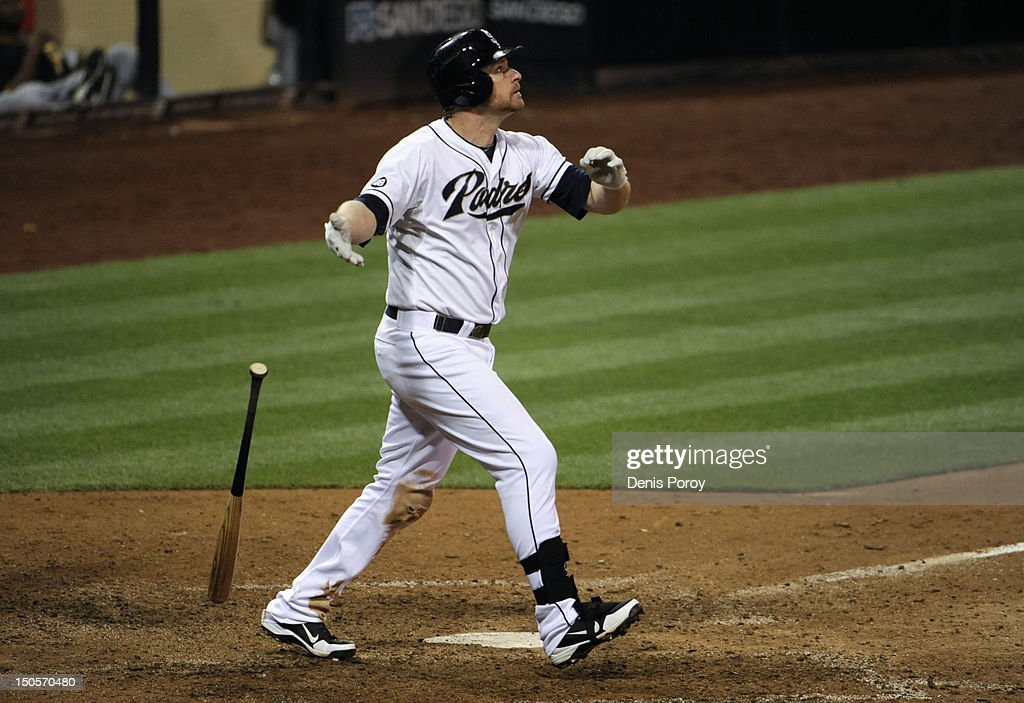 <a gi-track='captionPersonalityLinkClicked' href=/galleries/search?phrase=Chase+Headley&family=editorial&specificpeople=4353228 ng-click='$event.stopPropagation()'>Chase Headley</a> #7 of the San Diego Padres hits a walk-off home run in the 10th inning of a baseball game against the Pittsburgh Pirates at Petco Park on August 21, 2012 in San Diego, California. The Padres won 7-5.