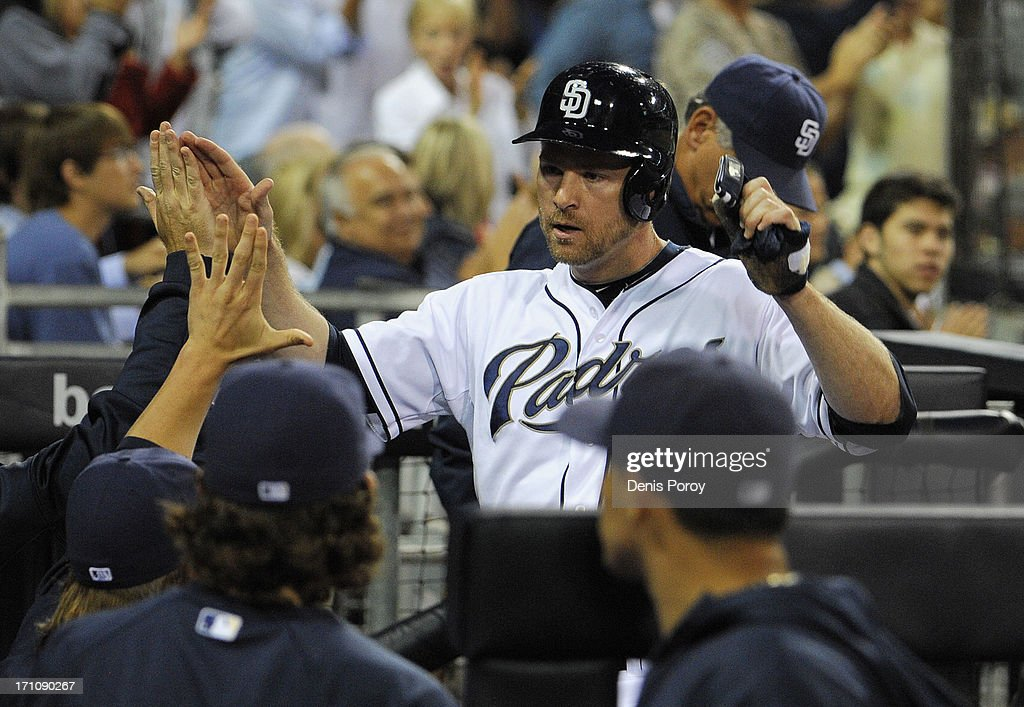 <a gi-track='captionPersonalityLinkClicked' href=/galleries/search?phrase=Chase+Headley&family=editorial&specificpeople=4353228 ng-click='$event.stopPropagation()'>Chase Headley</a> #7 of the San Diego Padres is congratulated after scoring during the third inning of a baseball game against the Los Angeles Dodgers at Petco Park on June 21, 2013 in San Diego, California.