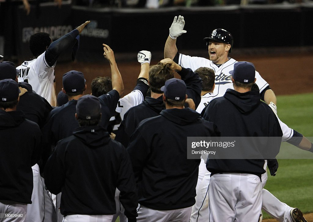 <a gi-track='captionPersonalityLinkClicked' href=/galleries/search?phrase=Chase+Headley&family=editorial&specificpeople=4353228 ng-click='$event.stopPropagation()'>Chase Headley</a> #7 (R) of the San Diego Padres is congratulated by team-mates after hitting a walk-off home run in the 10th inning of a baseball game against the Pittsburgh Pirates at Petco Park on August 21, 2012 in San Diego, California. The Padres won 7-5.