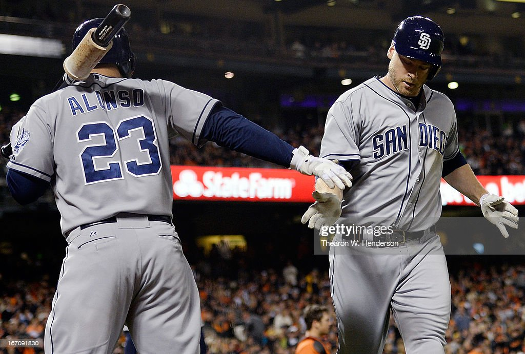 <a gi-track='captionPersonalityLinkClicked' href=/galleries/search?phrase=Chase+Headley&family=editorial&specificpeople=4353228 ng-click='$event.stopPropagation()'>Chase Headley</a> #15 of the San Diego Padres is congratulated by <a gi-track='captionPersonalityLinkClicked' href=/galleries/search?phrase=Yonder+Alonso&family=editorial&specificpeople=4424898 ng-click='$event.stopPropagation()'>Yonder Alonso</a> #23 after Headley hit a solo home run against the San Francisco Giants in the sixth inning at AT&T Park on April 19, 2013 in San Francisco, California.