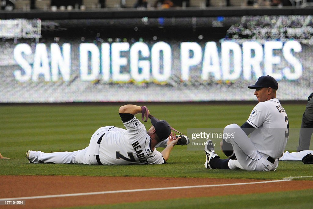Chase Headley of the San Diego Padres left and Ronny Cedeno stretch before a baseball game against the Pittsburgh Pirates at Petco Park on August 19...