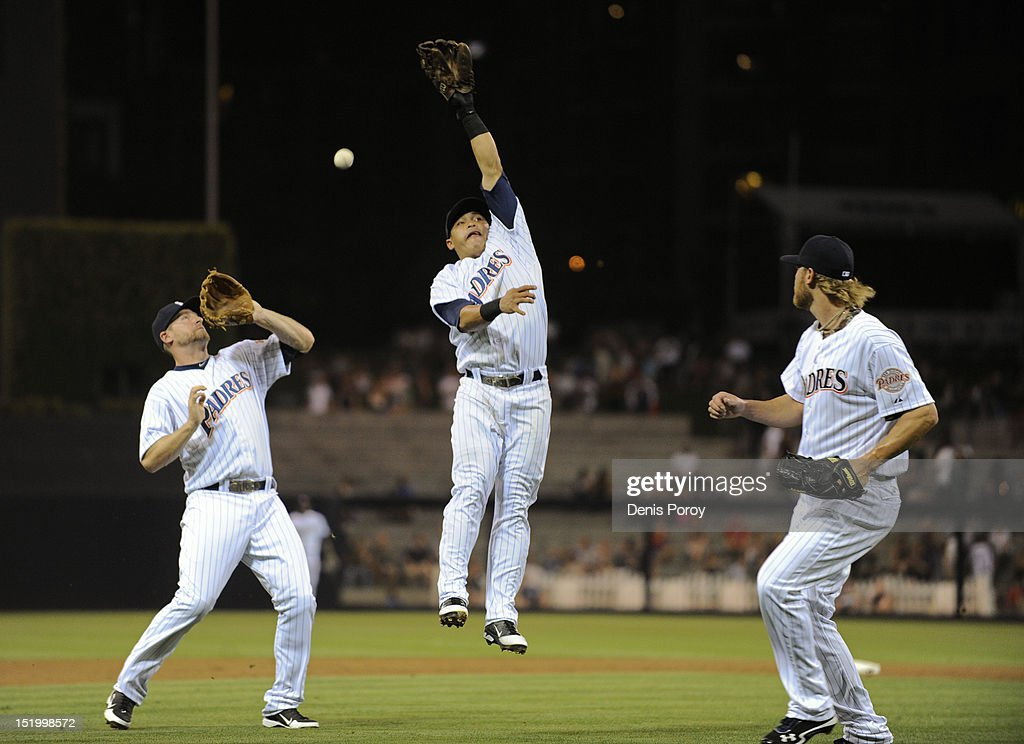 <a gi-track='captionPersonalityLinkClicked' href=/galleries/search?phrase=Chase+Headley&family=editorial&specificpeople=4353228 ng-click='$event.stopPropagation()'>Chase Headley</a> #7 of the San Diego Padres, left, <a gi-track='captionPersonalityLinkClicked' href=/galleries/search?phrase=Everth+Cabrera&family=editorial&specificpeople=5743470 ng-click='$event.stopPropagation()'>Everth Cabrera</a> #2, center, and <a gi-track='captionPersonalityLinkClicked' href=/galleries/search?phrase=Andrew+Cashner&family=editorial&specificpeople=5742254 ng-click='$event.stopPropagation()'>Andrew Cashner</a> #34, right, try for a single hit by Chris Nelson #10 of the Colorado Rockies during the first inning of a baseball game at Petco Park on September 14, 2012 in San Diego, California.