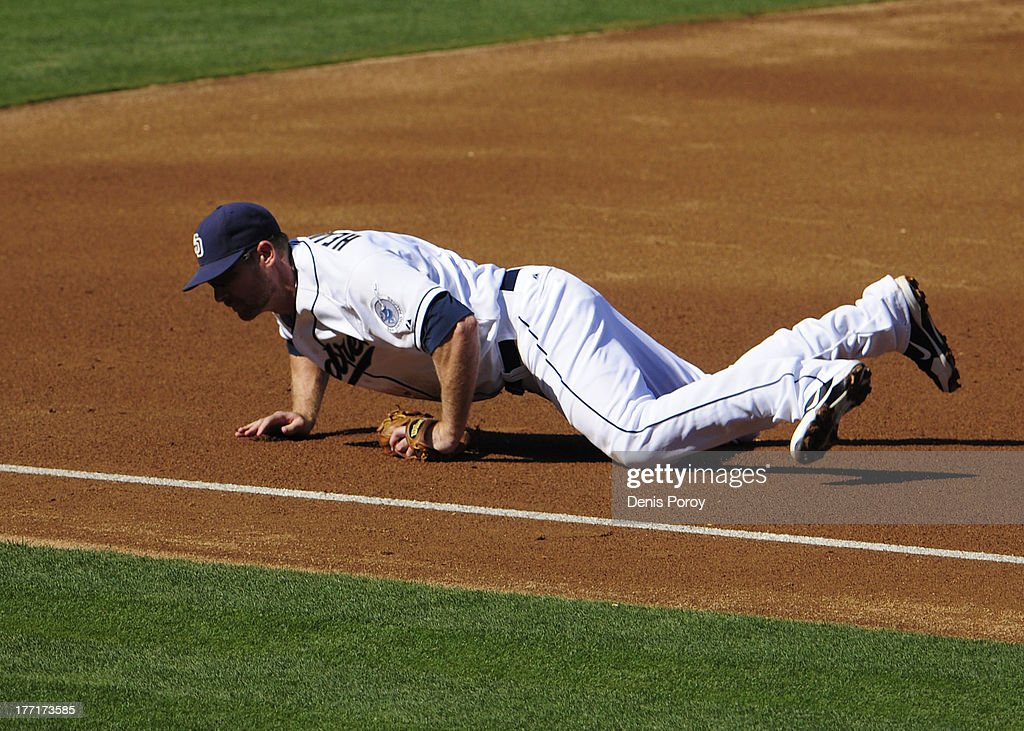 <a gi-track='captionPersonalityLinkClicked' href=/galleries/search?phrase=Chase+Headley&family=editorial&specificpeople=4353228 ng-click='$event.stopPropagation()'>Chase Headley</a> #7 of the San Diego Padres makes a diving stop on a ball hit by Gaby Sanchez #14 of the Pittsburgh Pirates during the second inning of a baseball game against the Pittsburgh Pirates at Petco Park on August 21, 2013 in San Diego, California. Sanchez was thrown out at first base.