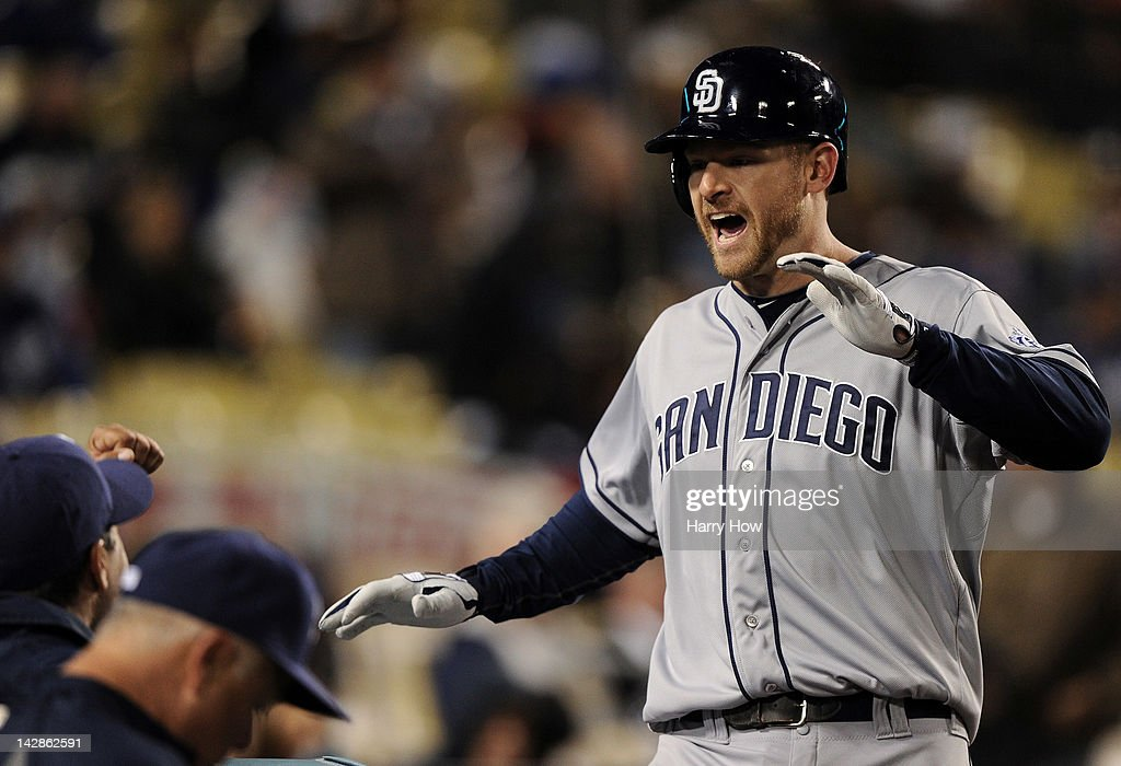 <a gi-track='captionPersonalityLinkClicked' href=/galleries/search?phrase=Chase+Headley&family=editorial&specificpeople=4353228 ng-click='$event.stopPropagation()'>Chase Headley</a> #7 of the San Diego Padres reacts to his two run homerun to tie the game 8-8 against the Los Angeles Dodgers during the ninth inning at Dodger Stadium on April 13, 2012 in Los Angeles, California.