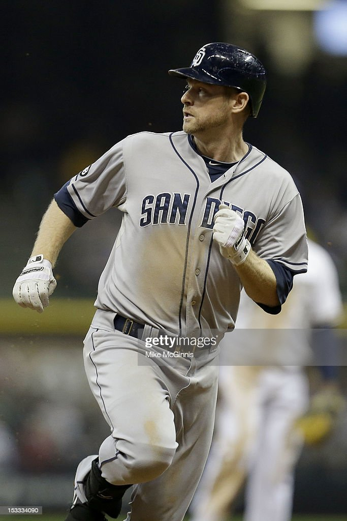 <a gi-track='captionPersonalityLinkClicked' href=/galleries/search?phrase=Chase+Headley&family=editorial&specificpeople=4353228 ng-click='$event.stopPropagation()'>Chase Headley</a> #7 of the San Diego Padres runs to third base on a triple scoring Will Venable in the top of the seventh inning against the Milwaukee Brewers at Miller Park on October 3, 2012 in Milwaukee, Wisconsin.