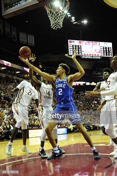 Chase Jeter forward/center Duke University Blue Devils reaches for a rebound in front of Terance Mann guard Florida State University Seminoles in an...